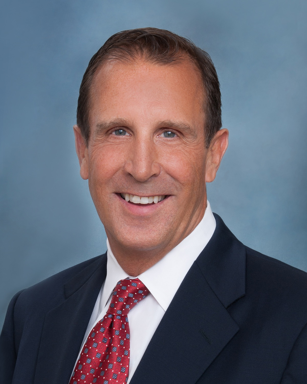 San Diego Notary, a man smiles in a suit and tie