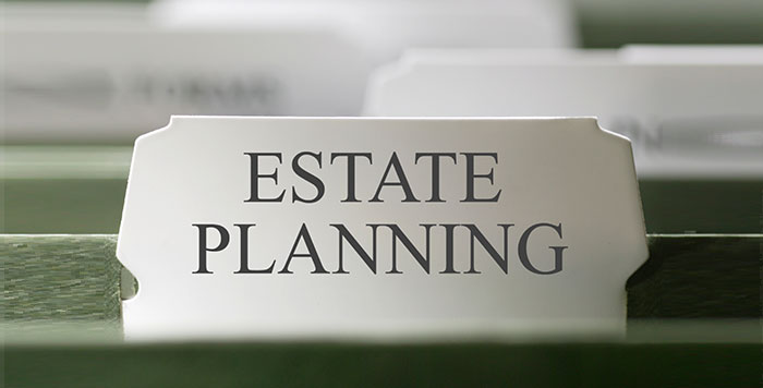 """San Diego Notary, a tab on a file folder reads """"estate planning"""", it is the first file in file cabinet"""