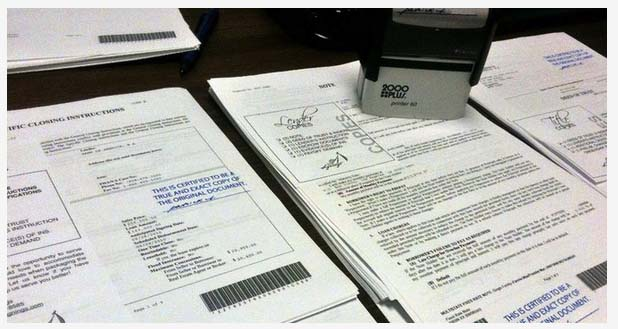 signed and organized loan documents for escrow and lender